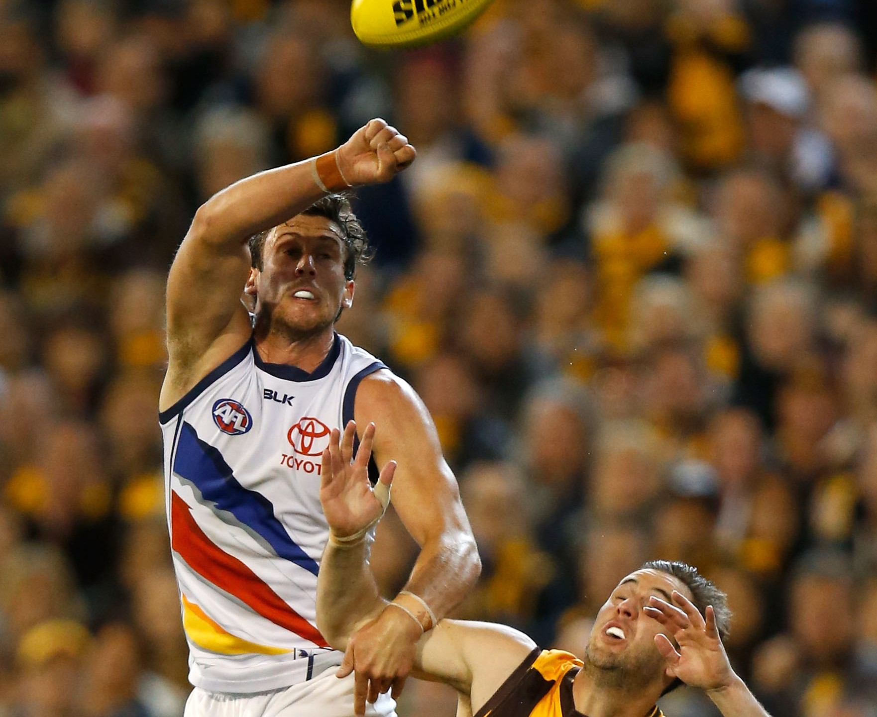 MELBOURNE, AUSTRALIA - SEPTEMBER 18: Kyle Hartigan of the Crows and Matthew Suckling of the Hawks during the 2015 AFL Second Semi Final match between the Hawthorn Hawks and the Adelaide Crows at the Melbourne Cricket Ground, Melbourne, Australia on September 18, 2015. (Photo by Michael Willson/AFL Media/Getty Images)