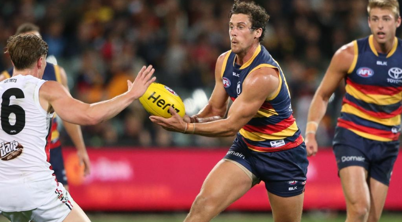Adelaide Crows defender Kyle Hartigan signs three-year contract extension to stay with the club until at least 2020
